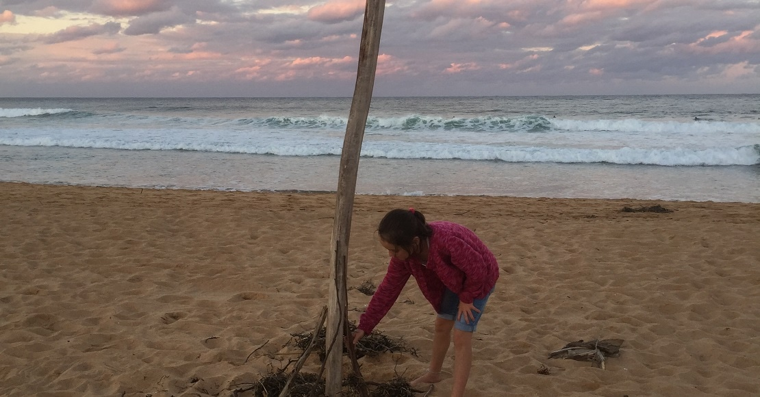 Young girl on beach at sunset